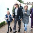 Kate Moss et sa fille Lila Grace quittent le Topshop Show Space après avoir assisté au défilé Topshop Unique. Londres, le 15 septembre 2013.