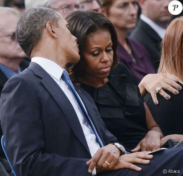 Le président Barack Obama et Michelle Obama ont assisté à une cérémonie hommage aux victimes de la tuerie de Navy Yard, le 22 septmbre 2013 à Washington. Le couple a réconforté les familles et le président a délivré un discours.