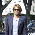 Le charmant frenchy Camille Lacourt arrive au défilé Armani le 23 septembre 2013 à Milan
