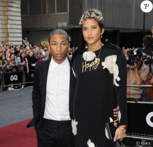 Pharrell Williams et Helen Lasichanh lors des GQ Men of the Year Awards à Londres, le 3 septembre 2013.