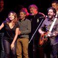 """John Manam et Julie Zenattià Lyon, le 12 octobre 2013, lors de la 7ème édition de """"Foot-Concert"""" au Palais des sports."""