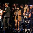"""Gregoire, Brice Conrad, Joyce Jonathan, Amel Bent et Gregory Coupetà Lyon, le 12 octobre 2013, lors de la 7ème édition de """"Foot-Concert"""" au Palais des sports."""