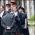 Victoria Beckham, enceinte, et son mari David au mariage du prince William et de Kate Middleton le 29 avril 2011 à Westminster