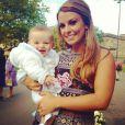 Coleen Rooney avec son bébé Klay, 6 mois, lors d'un mariage en octobre 2013