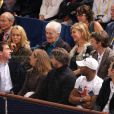 Manuel Valls, avec Jean Gachassin à sa droite, et Anne Gravoin, assise à côté d'Henri Leconte, devant Michèle Laroque et François Baroin au BNP Paribas Masters de Paris-Bercy le 1er novembre 2013, pour les quarts de finale du tournoi.