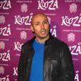 """Eric Judor à la représentation du nouveau spectacle du Cirque du Soleil, """"Kooza"""", sur l'ïle Seguin à Boulogne-Billancourt, le 26 novembre 2013."""