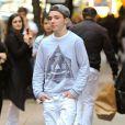 Rocci Ritchie quitte un centre de la Kabbale avec sa mère Madonna. New York, le 2 novembre 2013.