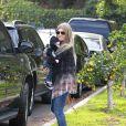 Fergie en compagnie de son mari Josh Duhamel et de leur fils Axl à Brentwood, le 12 janvier 2014.