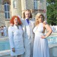 EXCLU : Morgan Ackermann (au centre) entouré de sa mère Pascale (à gauche) et de Cindy Lopes (à droite) lors de la White Party, organisée à Courcy-aux-Loges, le dimanche 7 juillet 2013.