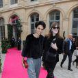 Farida Khelfa et Carla Bruni-Sarkozy au défilé Schiaparelli Haute couture printemps-été 2014 à Paris, le 20 janvier 2014.