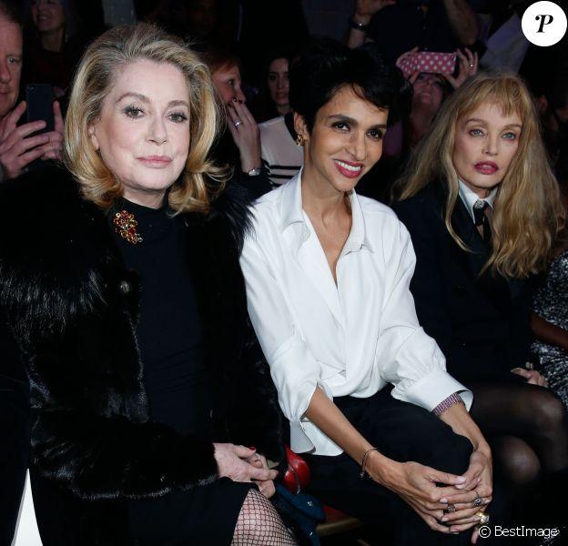 Catherine Deneuve, Farida Khelfa et Arielle Dombasleassistent au défilé haute couture printemps-été 2014 de Jean Paul Gaultier, dans son atelier situé dans le 3e arrondissement. Paris, le 22 janvier 2014.