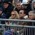 Arnold Schwarzenegger et Heather Milligan assistent à une compétition de ski à Kitzbuehel, en Autriche, le 25 janvier 2014.