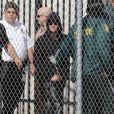 Justin Bieber sourit à sa sortie de prison à Miami, le 23 janvier 2014.