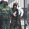 Justin Bieber sourit à sa sortie de prison à Miam, le 23 janvier 2014.