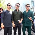 Nick Jonas, Joe Jonas, Kevin Jonas dans les rues de New York lors de la Fashion Week, le 5 septembre 2013.