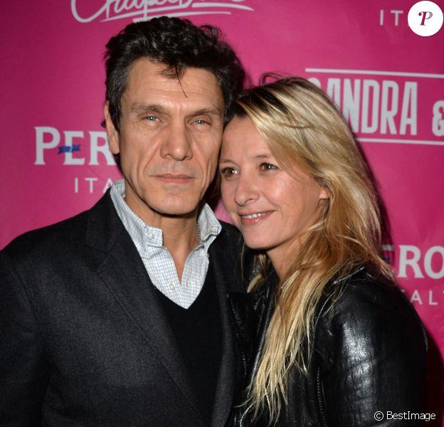 Marc et Sarah Lavoine lors de la contre-soirée de la Saint-Valentin par l'agence Sandra & CO au club Le Chapelier à Paris, le 14 février 2014.