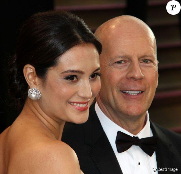 Bruce Willis et sa jolie Emma Heming, enceinte, à la soirée Vanity Fair suivant les Oscars à Los Angeles, le 2 mars 2014.