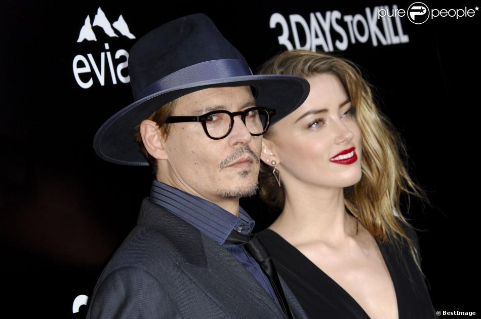 Johnny Depp et sa fiancée Amber Heard à la première du film 3 Days to Kill à Hollywood, le 12 février 2014.