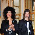 Samaha Sam et Frah du groupe Shaka Ponk décorés des insignes de chevalier de l'ordre des Arts et des Lettres par la ministre Aurélie Filippetti dans les salons du ministère de la Culture, à Paris le 18 mars 2014.