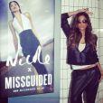 Nicole Scherzinger pose devant une affiche pour sa collection pour la marque Missguided.DR