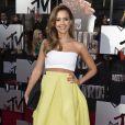 Jessica Alba assiste aux MTV Movie Awards 2014 au Nokia Theatre L.A. Live, habillée d'un top Piece d'Anarchive, d'une jupe Kenzo, d'une pochette Narciso Rodriguez pour Bottletop et de souliers Jimmy Choo. Los Angeles, le 13 avril 2014.