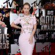 Iggy Azalea assiste aux MTV Movie Awards 2014 au Nokia Theatre L.A. Live, habillée d'une robe et de sandales John Galliano (collection printemps-été 2014). Los Angeles, le 13 avril 2014.