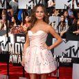 Christy Teigen assiste aux MTV Movie Awards 2014 au Nokia Theatre L.A. Live, habillée d'une robe Ulyana Sergeenko. Los Angeles, le 13 avril 2014.