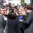 Sophie Barjac et le fils de Michel Lang, Franz-Rudolf Lang, lors des obsèques du réalisateur Michel Lang en l'église Notre-Dame de Grâce de Passy à Paris le 29 avril 2014