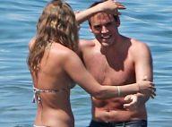 Sam Claflin, beau gosse de Hunger Games: Grassouillet à la plage avec sa femme