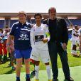 Guy Roux, Jamel Debbouze et Roland Courbis lors d'un match caritatif en juin 2013 à Marrakech
