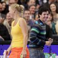 Rory McIlroy et Caroline Wozniacki lors d'un match exhibition durant le BNP Paribas Showdown au Madison Square Garden de New York le 5 mars 2012