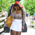 """""""Serena Williams au téléphone, sur une plage à Miami, le 31 mai 2014."""""""