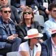 Jean-Luc Reichmann et sa compagne Nathalie aux Internationaux de France de tennis de Roland-Garros à Paris, le 1er juin 2014.