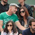 Jean-Marc Barr et sa compagne aux Internationaux de France de tennis de Roland-Garros à Paris, le 1er juin 2014.