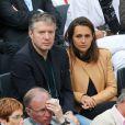 Thierry Rey et sa compagne aux Internationaux de France de tennis de Roland-Garros à Paris, le 1er juin 2014.