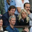 Marie Sara et son mari Christophe Lambert aux Internationaux de France de tennis de Roland-Garros à Paris, le 1er juin 2014.
