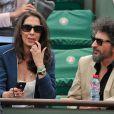 Radu Mihaileanu et sa compagne aux Internationaux de France de tennis de Roland-Garros à Paris, le 1er juin 2014.