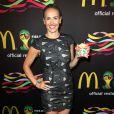 """L'ex-joueuse de football Heather Mitts assiste à la soirée FIFA World Cup McDonald's, célébrant la sortie du nouveau design de l'emballage des frites et du jeu Peel Play Ole"""". New York, le 5 juin 2014."""