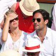 Sylvie Tellier et son compagnon Laurent à la finale homme des Internationaux de France de tennis de Roland Garros à Paris le 8 juin 2014.
