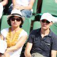 Gilles Bouleau et sa femme à la finale homme des Internationaux de France de tennis de Roland Garros à Paris le 8 juin 2014.