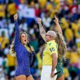 Claudia Leitte, Pitbull et Jennifer Lopez lors de la cérémonie d'ouverture du Mondial 2014 à Sao Paulo, le 12 juin 2014.