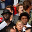 Lilian Thuram et son fils Kephren lors du match entre le Paris Saint-Germain et Guingamp au Parc des Princes à Paris le 31 août 2013