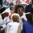 Serena Williams totalement désorientée et en perdition alors qu'elle disputait le double avec sa soeur Venus à Wimbledon, le 1er juillet 2014