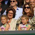 Mirka Federer avec ses filles Charlene et Myla, a assisté avec émotion à la finale de son époux Roger Federer opposé à Novak Djokovic, le 6 juillet 2014 au All England Lawn Tennis and Croquet Club de Wimbledon