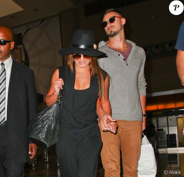 Lea Michele et son nouveau petit ami Matthew Paetz à l'aéroport de Los Angeles, le 15 juillet 2014.