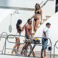 Selena Gomez avec Cara Delevingne et proche de Tommy Chiabra, à Saint-Tropez, le 22 juillet 2014, jour de son anniversaire.