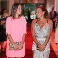 La princesse Stéphanie de Monaco et sa fille Pauline Ducruet lors du gala de l'association Fight Aids Monaco qui célébrait ses dix ans, au Sporting de Monte Carlo, le 25 juillet 2014
