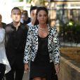 Tulisa Contostavlos devant le tribunal de Southwark, le 15 juillet 2014 à Londres