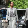 Tulisa Contostavlos arrive au palais de justice de Southwark à Londres, le 27 juin 2014, pour une audience dans l'affaire qui l'oppose à un blogueur qu'elle est accusée d'avoir agressé.