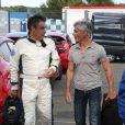 Exclusif - Cyril Viguier rencontre François Fillon au Mans, le 4 juillet 2014, sur le circuit des 24 Heures du Mans à l'occasion du Mans Classic.